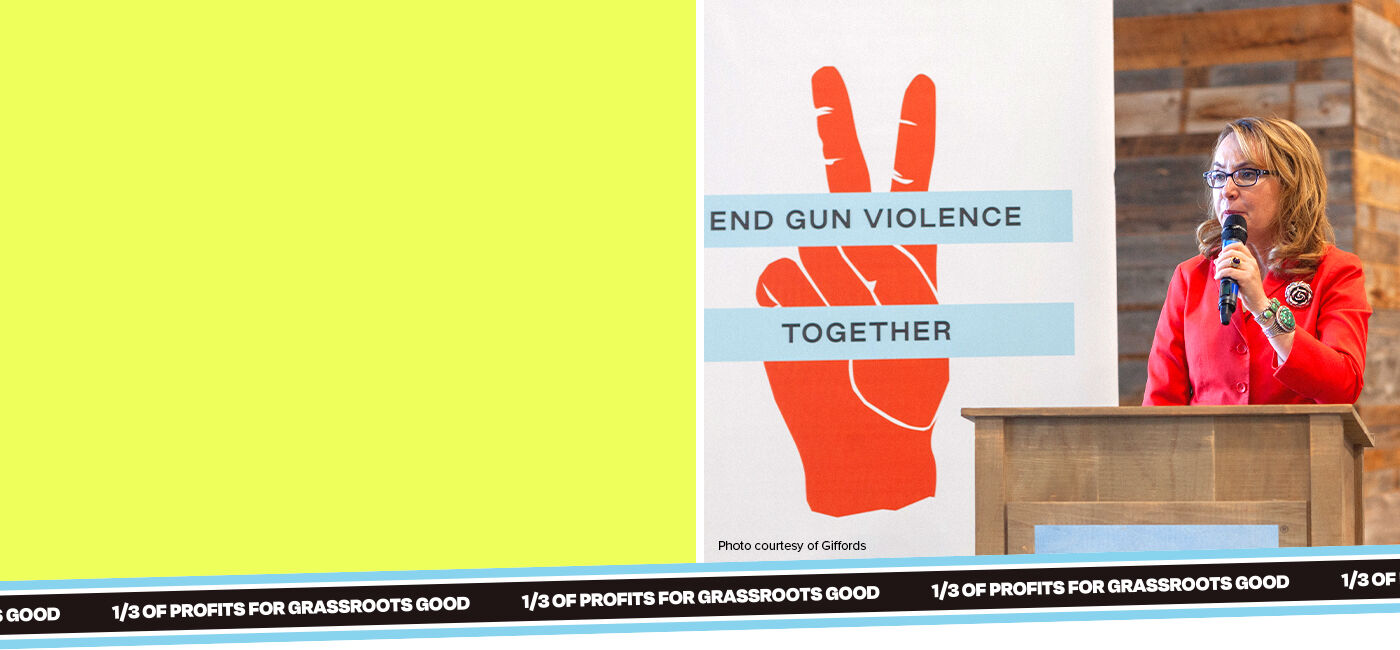 Photo: A woman standing at a podium with a microphone. Poster in the background: peace sign and End Gun Violence Together text. Caption: photo courtesy of Giffords. Text on ribbon: 1/3 of profits for Grassroots Good.