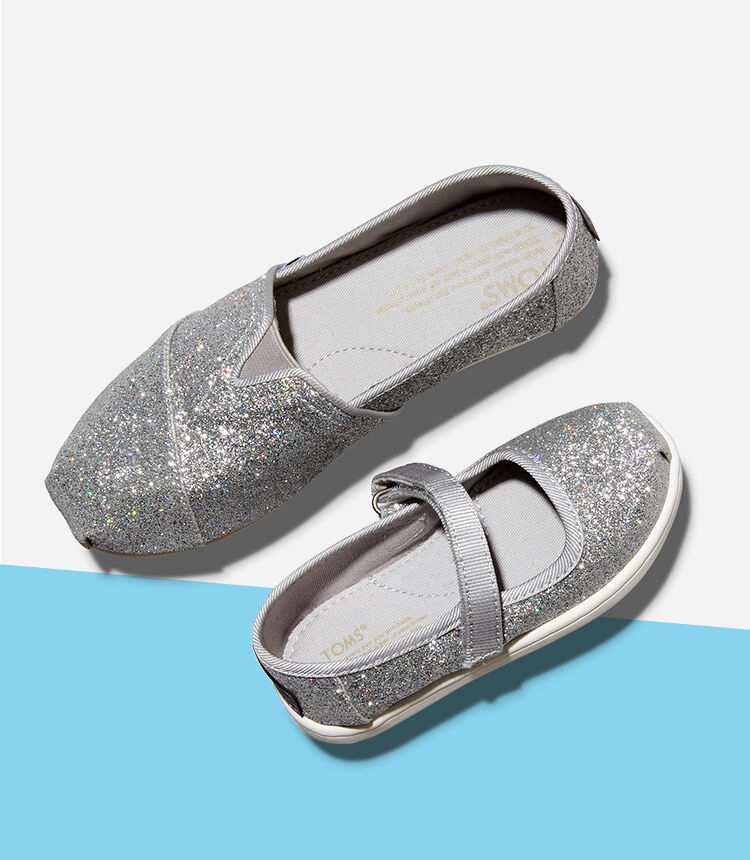 Kids' Tiny Mary Jane and Youth's Alpargata Glitter in silver iridescent shown.