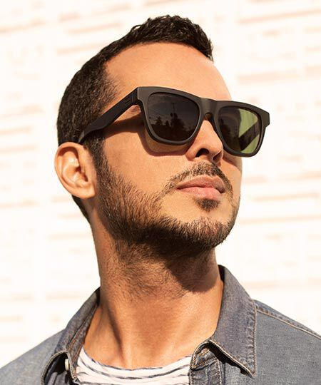 A model wearing the TOMS Traveler Dalston Matte Black Sunglasses
