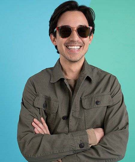 Man smiling and wearing TOMS unity collection sunglasses