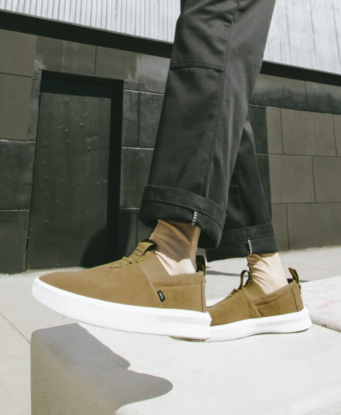 On model cropped feet view showing the Men's Alpargata Rover Water Resistant in dirty olive.