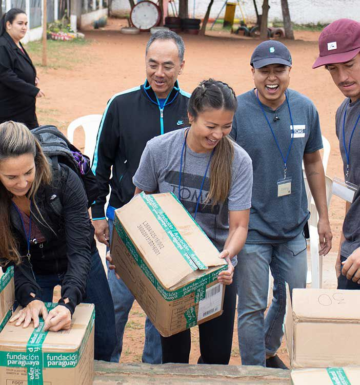 TOMS employees participating organizing boxes