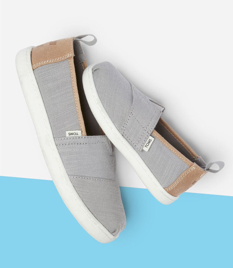 Kids' grey Alpargatas in tiny and youth shown.