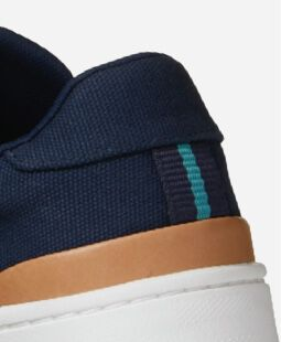 close up shot of TOMS TRVL Lite navy sneaker heel