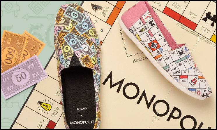 Men's and Women's Monopoly alpargatas on a monopoly game board background