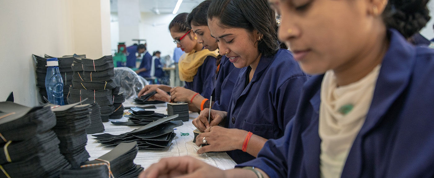 An image of workers at a TOMS factory
