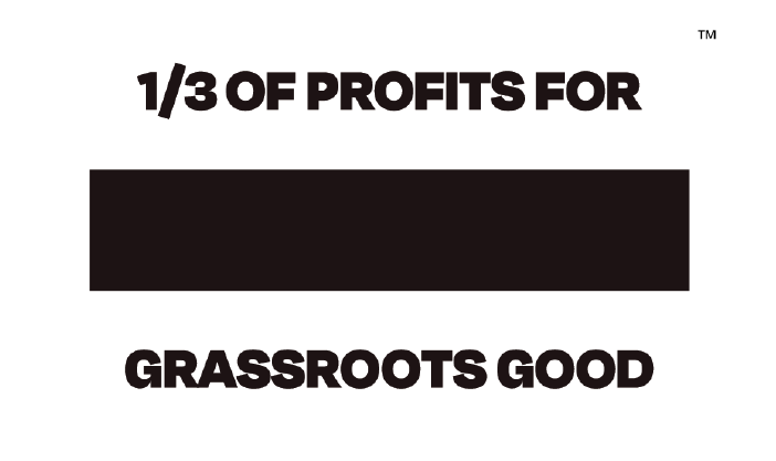 TOMS flag. Text: One third of profits for Grassroots Good. Trademark symbol.