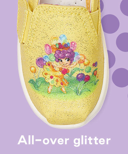 Close up image of the Princess Lolly design on the TOMS X Candy Land Yellow Princess Lolly Tiny Alpargata