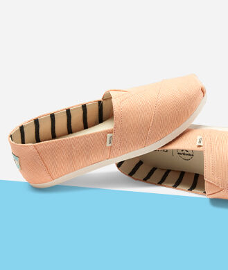 Women's Alpargatas light orange heritage canvas.