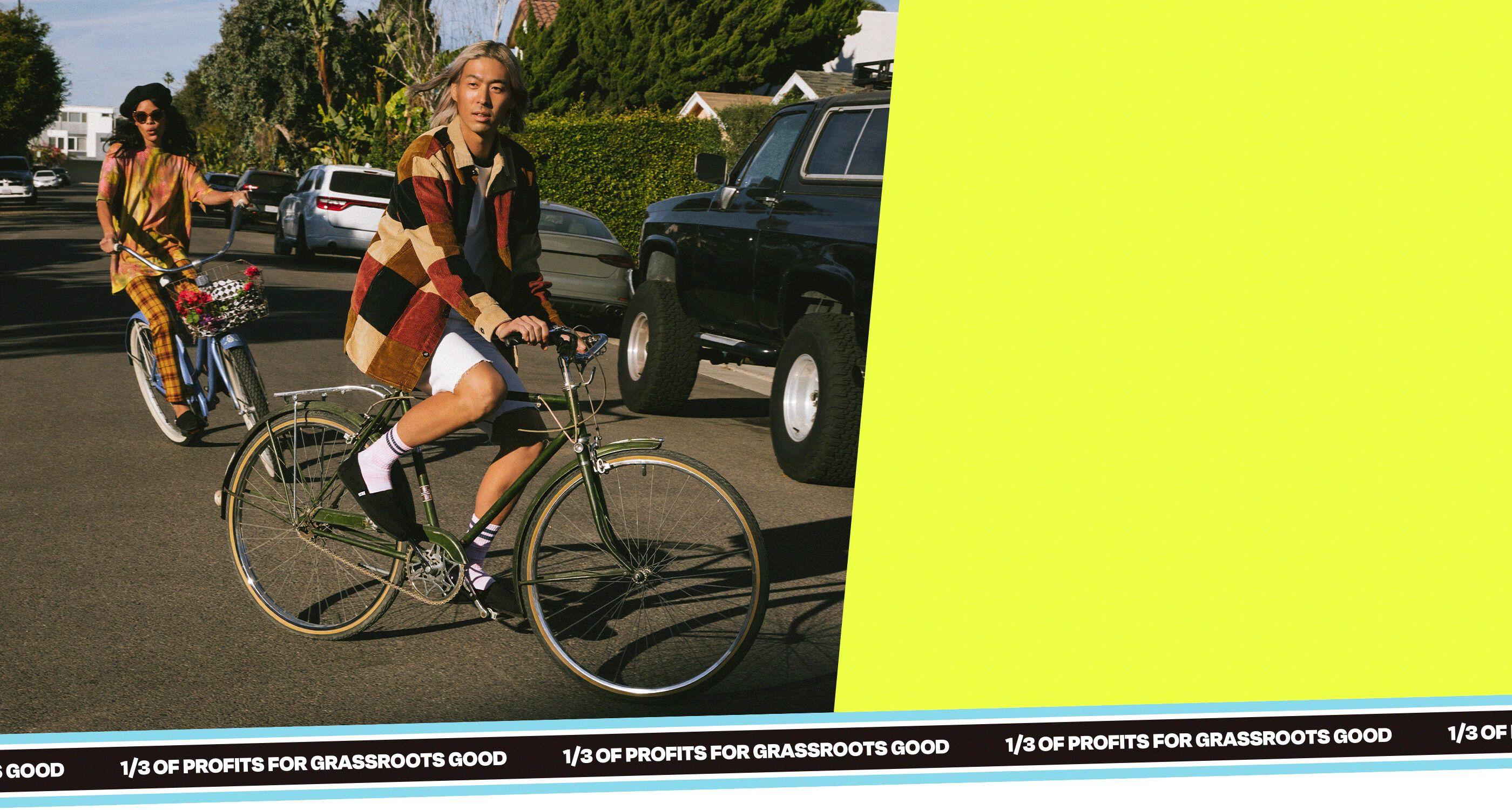 Models on bicycles wearing Alpargata Canvas black on black style.
