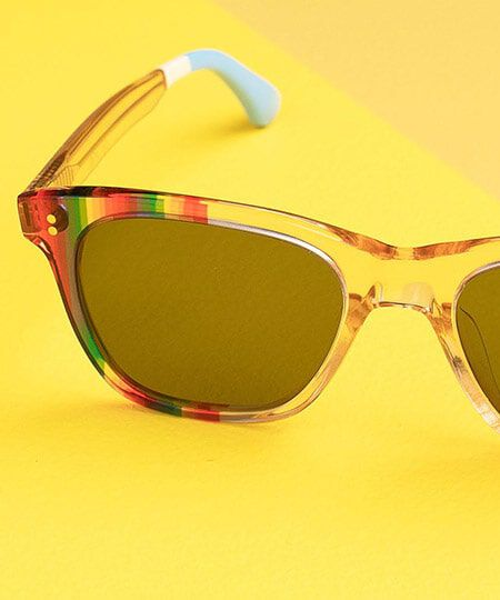 Pair of TOMS Unity Collection Sunglasses on a Yellow Background