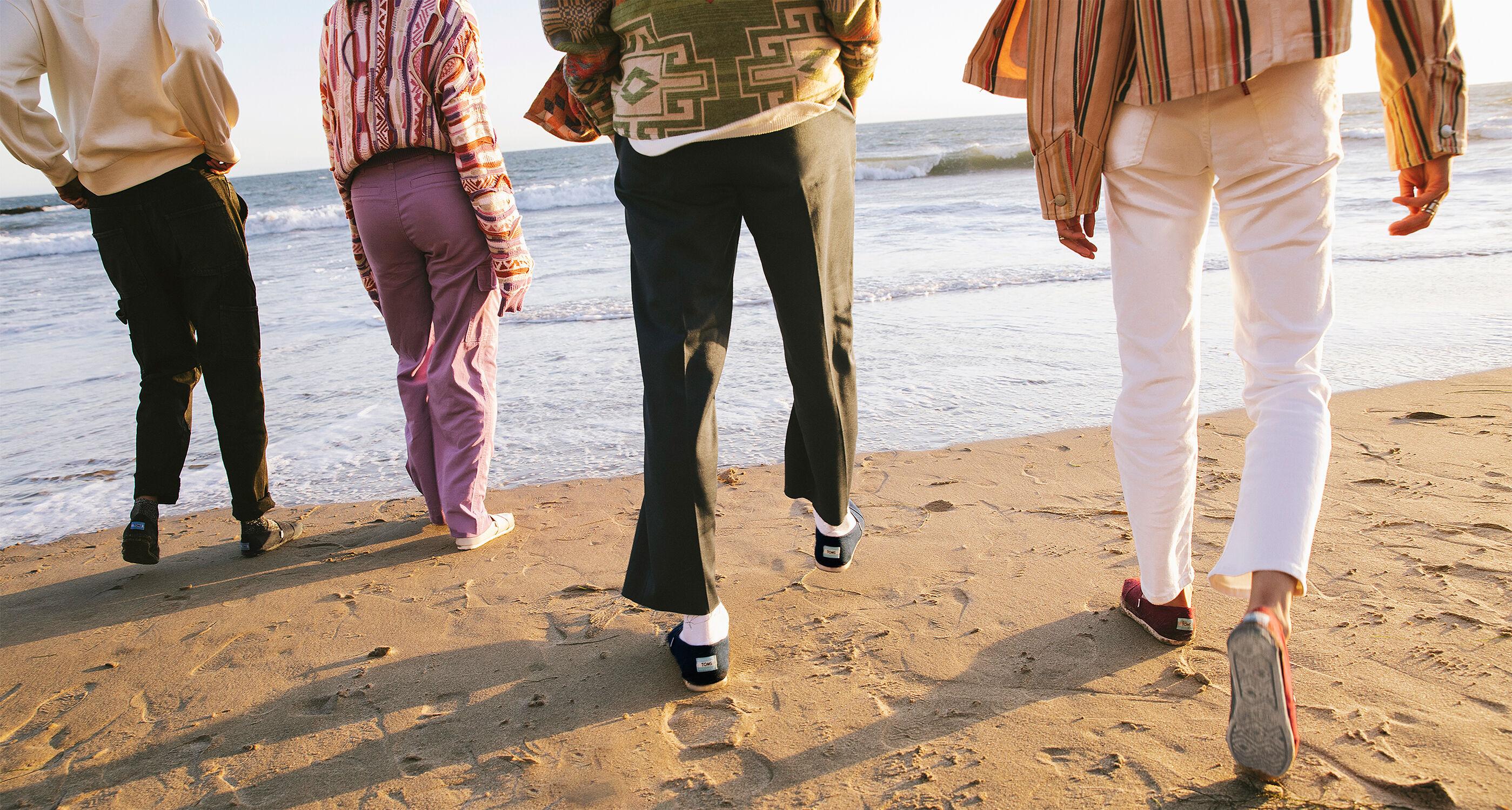 Models wearing Alpargatas at the beach.