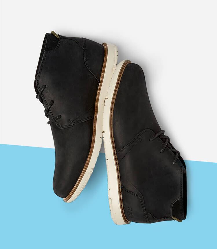 Men's Navi Boot in black shown.