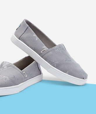 Women's grey slip ons.