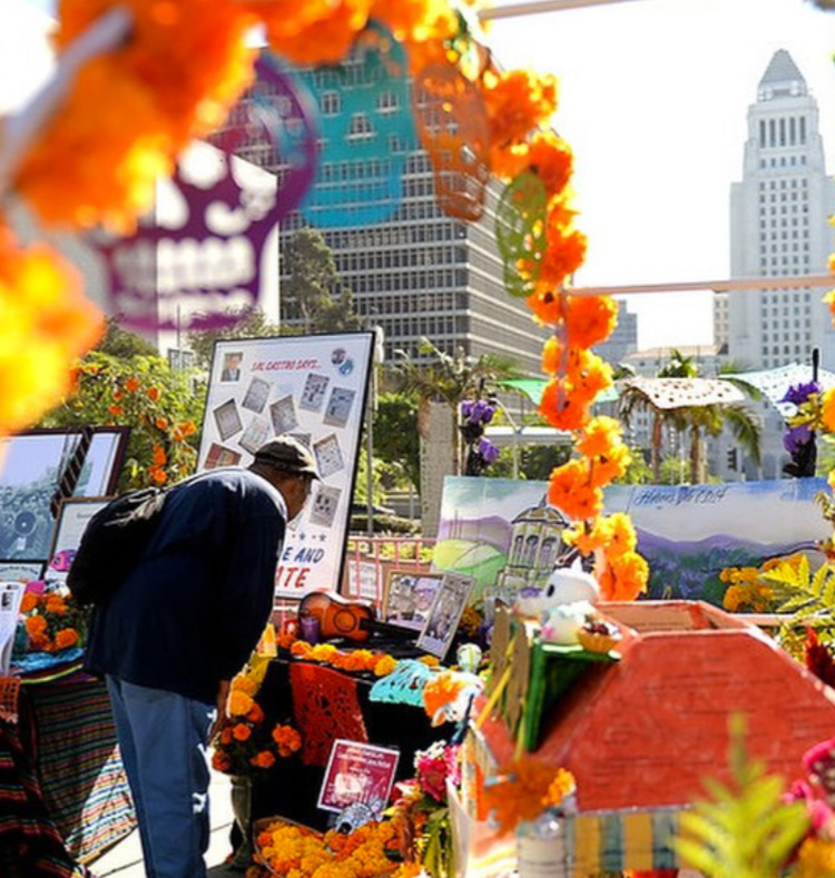 A structure with images of the dead at a Dia De Los Muertos event.
