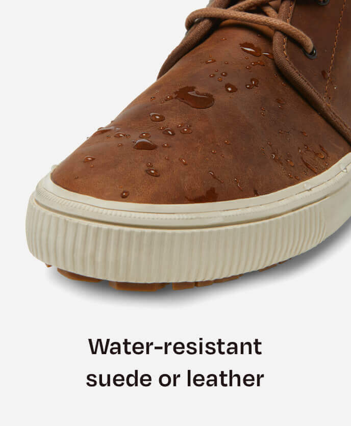 Close up of Carlo Mid Terrain Sneaker toe cap in Topaz Brown fabric with water on it to showcase the water-resistant leather.