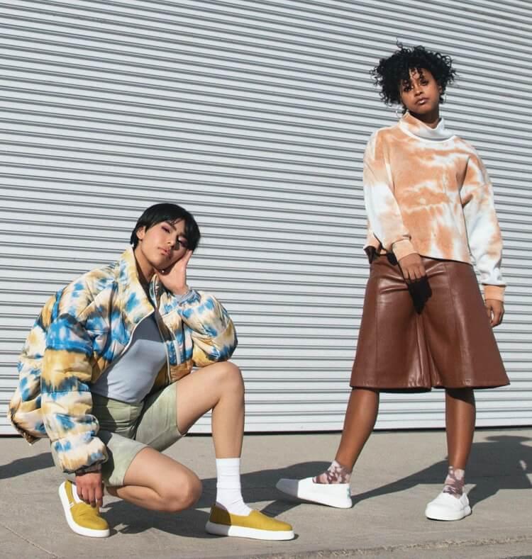 Models wearing Alpargata Mallow in dark mustard and white styles.