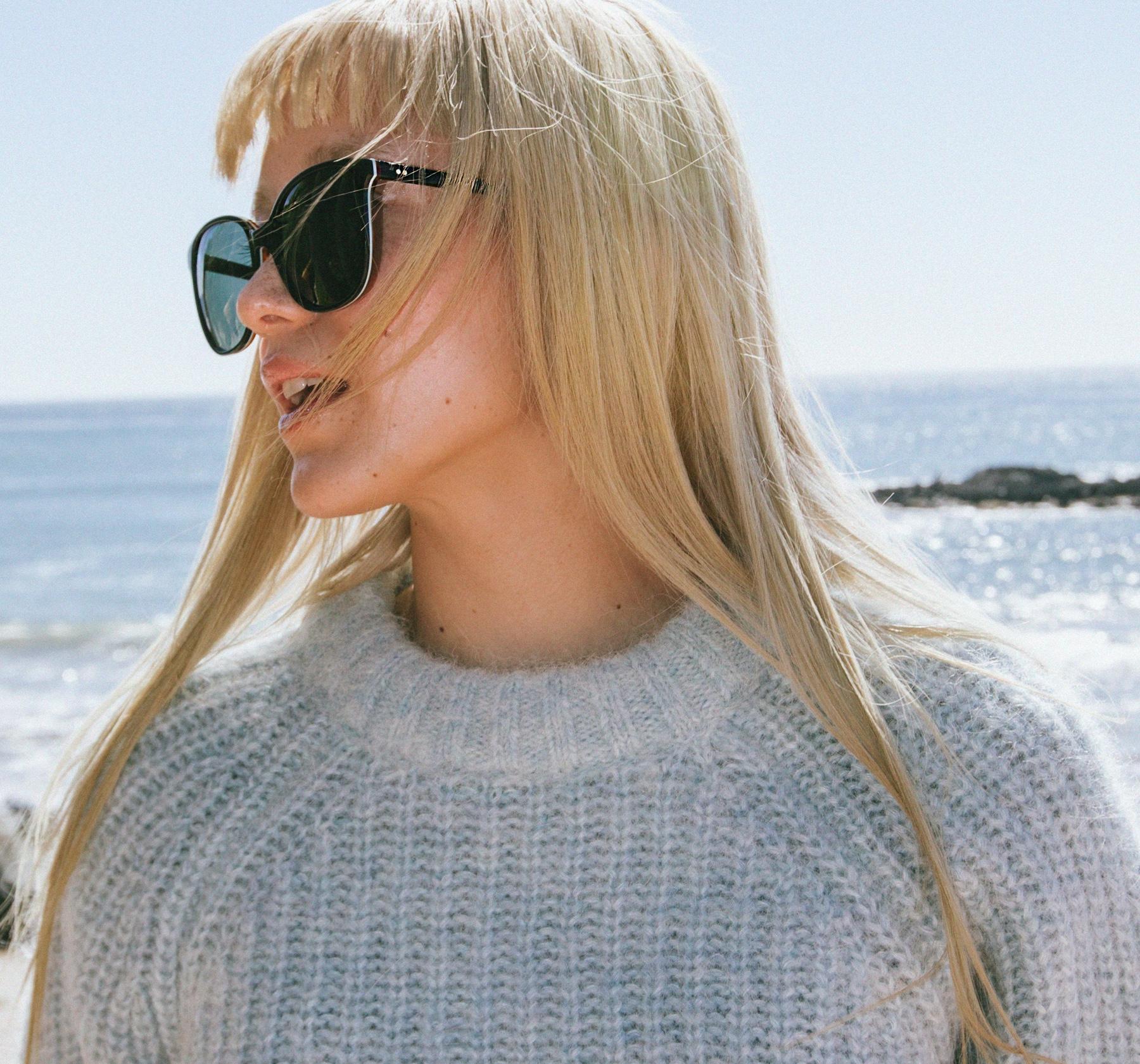 Model wearing Sandela Toms Blue Multi Lamination sunglasses.