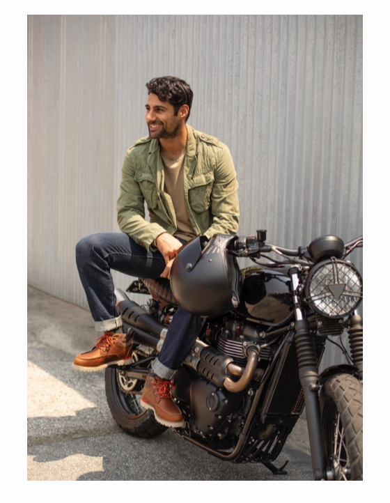 Model sitting on motorcycle wearing men's Hawthorne boots.
