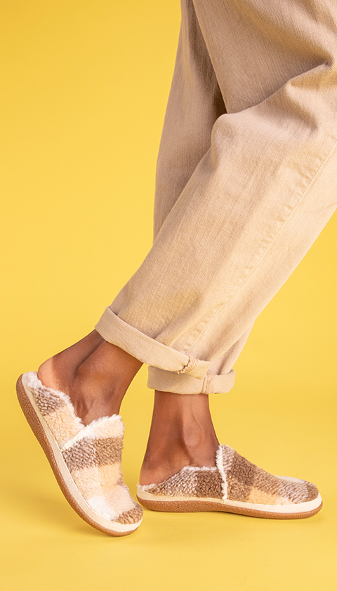 Model wearing India Slipper in brown multi shown.