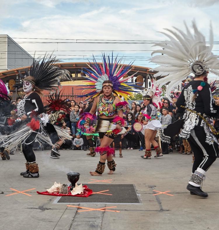 Dancers performing at a Dia De Los Muertos event.