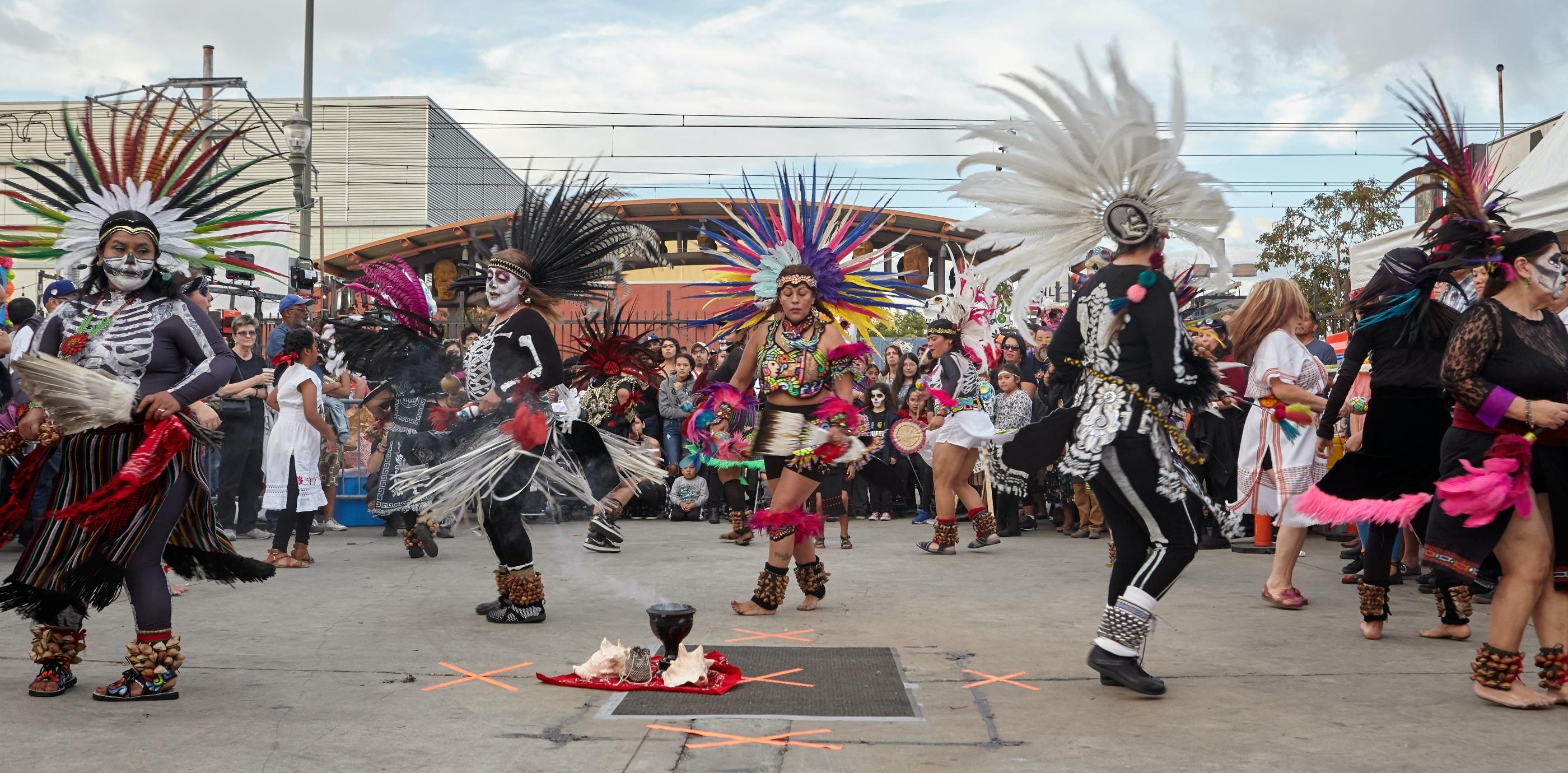 Performing dancers at a Dia De Los Muertos event.